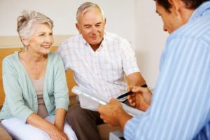 elderly couple talking to an insurance broker about retirement and life insurance